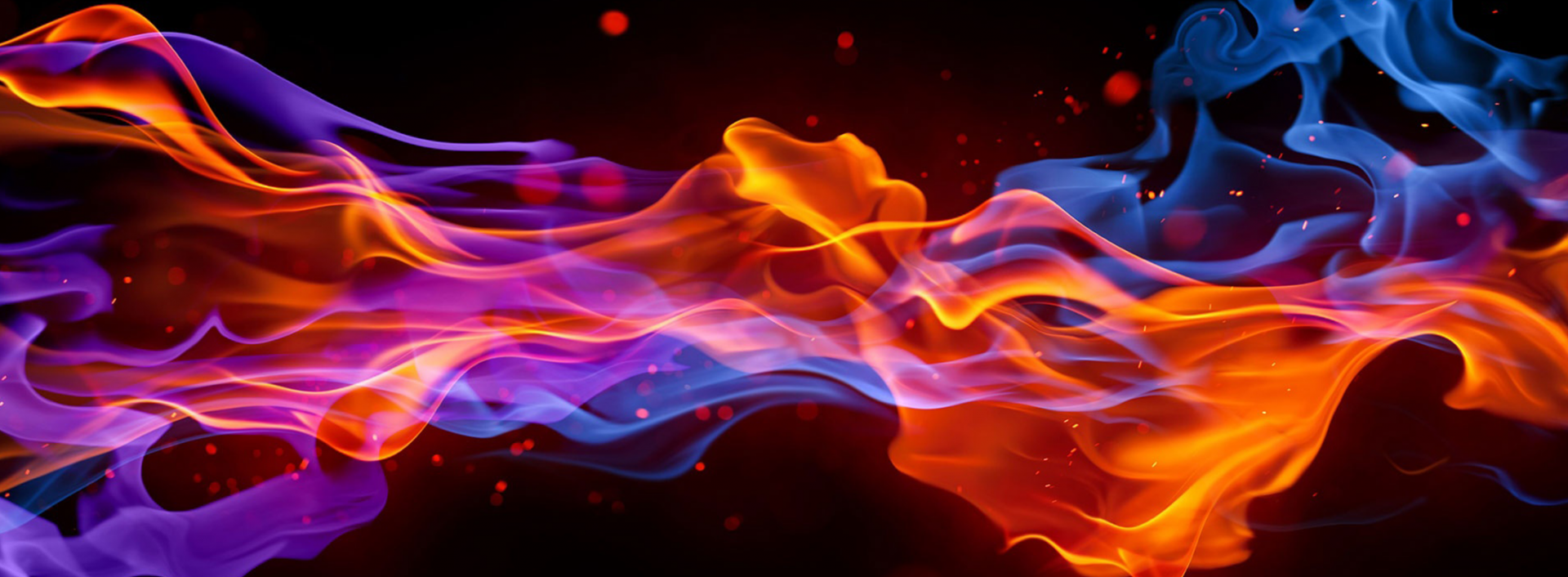 Coloured flames on black background